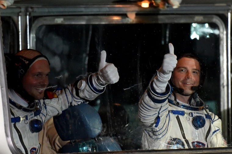 European Space Agency's German astronaut Alexander Gerst (L) and US NASA astronaut Gregory Wiseman wave after their space suits were tested at the Russian-leased Baikonur cosmodrome, prior to blasting off to the International Space Station (ISS) late on May 28, 2014 . The launch of the Soyuz TMA-13M with the international crew aboard is scheduled early on May 29 local time. (Kirill Kudryavtsev/AFP/Getty Images)