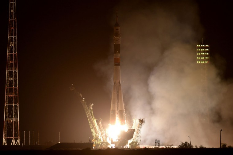 Russia's Soyuz TMA-13M spacecraft carrying the International Space Station (ISS) crew of European Space Agency's German astronaut Alexander Gerst, Russian cosmonaut Maxim Suraev and US NASA astronaut Gregory Wiseman blasts off from the launch pad at Russian-leased Baikonur cosmodrome, early on May 29, 2014. (Kirill Kudryavtsev/AFP/Getty Images)