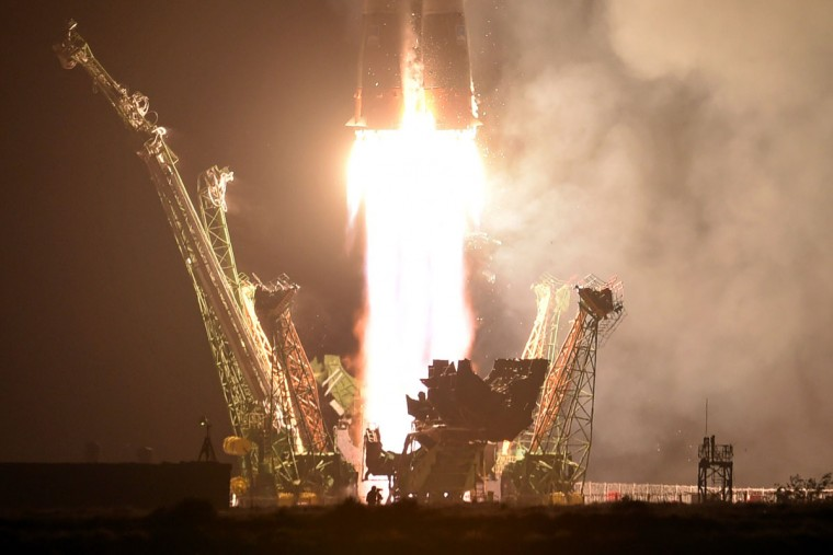 Russia's Soyuz TMA-13M spacecraft carrying the International Space Station (ISS) crew of European Space Agency's German astronaut Alexander Gerst, Russian cosmonaut Maxim Suraev and US NASA astronaut Gregory Wiseman blasts off from the launch pad at Russian-leased Baikonur cosmodrome early on May 29, 2014. (Kirill Kudryavtsev/AFP/Getty Images)