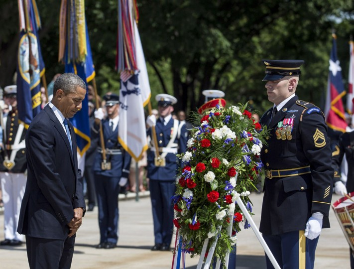 U.S. President Barack Obama lays a wreath at the Tomb of the Unknown Soldier at Arlington National Cemetery, May 26, 2014 in Arlington, Virginia. Obama returned to Washington the morning of May 26, after a surprise visit to Afghanistan to visit U.S. troops at Bagram Air Field. (Pool photo by Drew Angerer/Getty Images)