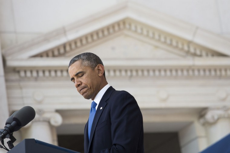 U.S. President Barack pauses while speaking during a Memorial Day event at Arlington National Cemetery, May 26, 2014 in Arlington, Virginia. Obama returned to Washington the morning of May 26, after a surprise visit to Afghanistan to visit U.S. troops at Bagram Air Field. (Pool photo by Drew Angerer/Getty Images)