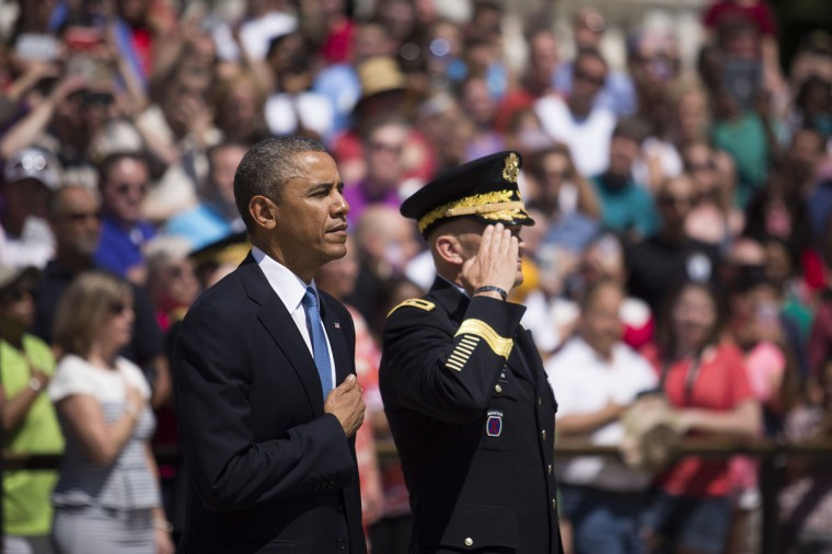President Barack Obama and Major General Jeffrey Buchanan participate in a wreath laying ceremony at the Tomb of the Unknown Soldier at Arlington National Cemetery, in Arlington, Va., on May 26, 2014. (Drew Angerer/SIPA/Abaca Press/MCT)