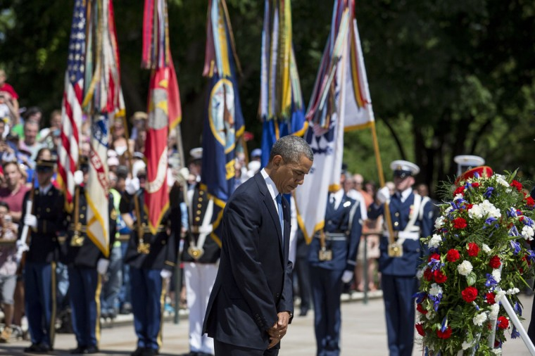 President Barack Obama pauses after laying a wreath at the Tomb of the Unknown Soldier at Arlington National Cemetery, in Arlington, Va., on May 26, 2014. (Drew Angerer/SIPA/Abaca Press/MCT)
