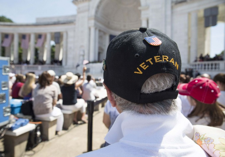 A World War II veteran attends Memorial Day ceremonies at Arlington National Cemetery in Virginia May 26, 2014. REUTERS/Joshua Roberts