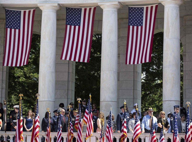 Flags are draped from the amphitheater as U.S. President Barack Obama takes part in Memorial Day ceremonies at Arlington National Cemetery in Virginia May 26, 2014. REUTERS/Joshua Roberts
