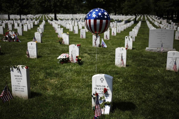 A balloon decorates a grave in Section 60, where many casualties of the U.S. wars in Iraq and Afghanistan are buried, on Memorial Day at Arlington National Cemetery in Arlington, Virginia May 26, 2014. President Obama marked Memorial Day and the 150th anniversary of the cemetery Monday by laying a wreath to honor the soldiers buried there since the Civil War. REUTERS/Jonathan Ernst