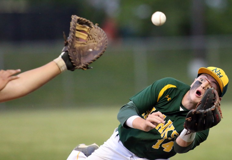 North Harford infielder Braden Stinar, right, stretches out to make an amazing catch during a game against La Plata high school at Joe Canon Stadium in Hanover. (Daniel Kucin Jr./For The Baltimore Sun)