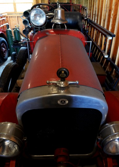 An antique firetruck sits in one of the garages on Scott Shearer's farm. (Jon Sham/BSMG)