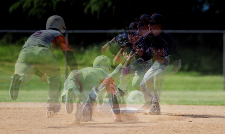 Governor Thomas Johnson second baseman Tommy Phelps and Reservoir's Danny O'Hagan, sliding. (Jon Sham/BSMG)