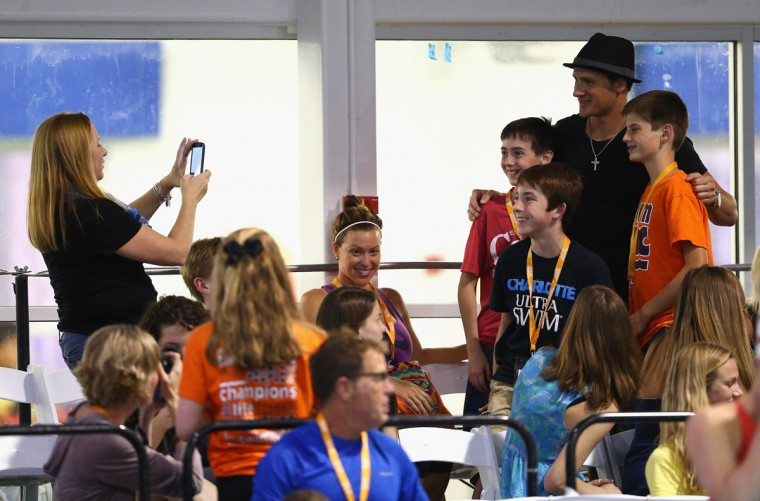 Fans take pictures with swimmer Ryan Lochte during day 1 of the Arena Grand Prix at Charlotte at Mecklenburg County Aquatic Center on May 16, 2014 in Charlotte, North Carolina. (Streeter Lecka/Getty Images)