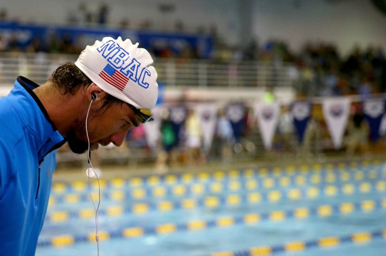 Michael Phelps prepares before the men's 200m freestyle preliminaries during day 1 of the Arena Grand Prix at Charlotte at Mecklenburg County Aquatic Center on May 16, 2014 in Charlotte, North Carolina. (Streeter Lecka/Getty Images)