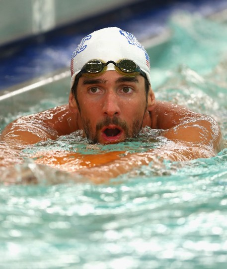 Michael Phelps prepares before the men's 100m butterfly final during day 1 of the Arena Grand Prix at Charlotte at Mecklenburg County Aquatic Center on May 16, 2014 in Charlotte, North Carolina. (Streeter Lecka/Getty Images)