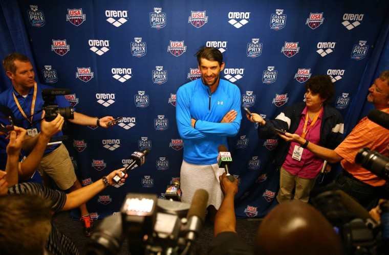 Michael Phelps speaks to the media after winning the men's 100m butterfly final during day 1 of the Arena Grand Prix at Charlotte at Mecklenburg County Aquatic Center on May 16, 2014 in Charlotte, North Carolina. (Streeter Lecka/Getty Images)