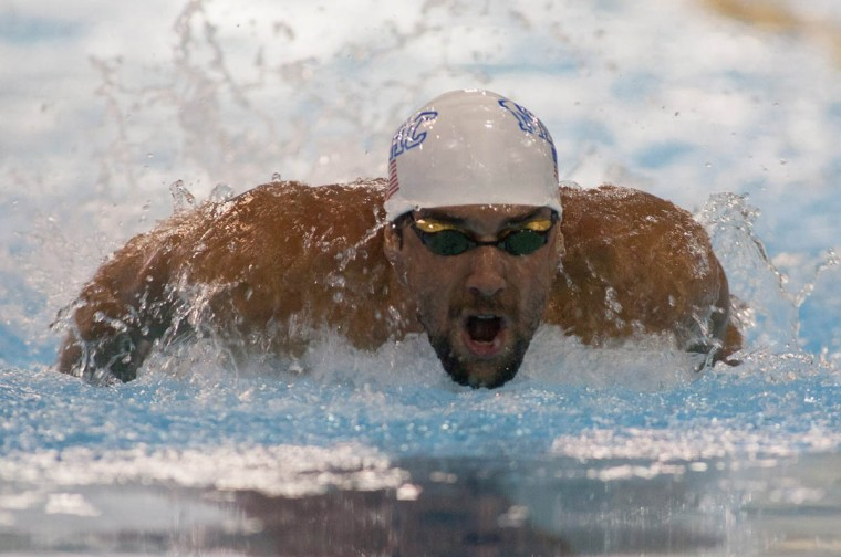 Michael Phelps swims in the 100 meter butterfly final at Mecklenburg County Aquatic Center. (Jeremy Brevard/USA TODAY Sports)
