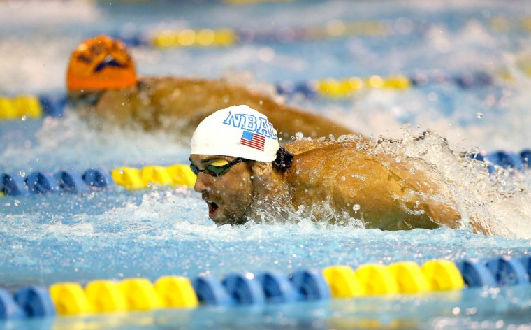 Michael Phelps wins the men's 100m butterfly final during day 1 of the Arena Grand Prix at Charlotte at Mecklenburg County Aquatic Center on May 16, 2014 in Charlotte, North Carolina. (Streeter Lecka/Getty Images)