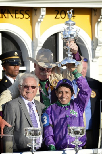 Jockey Victor Espinoza celebrates with co-owner Steve Coburn, in back with cowboy hat and trainer Art Sherman, left, after California Chrome was victorious in the 139th Preakness Race. (Kim Hairston/Baltimore Sun)