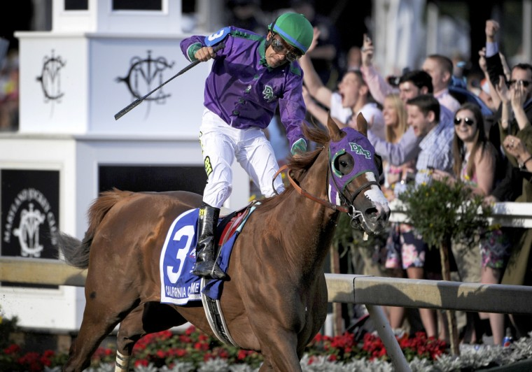California Chrome, ridden by Victor Espinoza, wins the 139th Preakness Stakes at Pimlico Race Course. The horse was a heavy favorite after winning the Kentucky Derby. (Christopher T. Assaf/Baltimore Sun Staff)