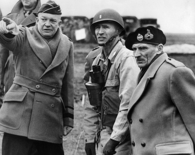Supreme Commander of the Allied Forces, General Dwight D. Eisenhower (left) shows the strain of his command as he and Britain's Field Marshal Bernard Montgomery (right), his deputy commander, confer on the invasion plans of Normandy in an unknown location in June 1944 after Allied forces stormed the Normandy beaches on D-Day. (AFP/Getty Images)