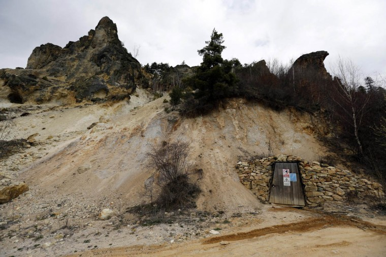 The entrance of a closed goldmine gallery is seen near Rosia Montana, central Romania, March 24, 2014. Romania's lower house rejected a bill on June 3 that would have enabled Canada's Gabriel Resources to set up Europe's biggest open-cast gold mine in the small Carpathian town of Rosia Montana, putting the project on hold indefinitely. The bill, which was initially approved by the leftist government of Prime Minister Victor Ponta, drew thousands of anti-mine protesters into the streets across the European Union state last year, prompting the senate to strike it down. (Bogdan Cristel/Reuters photo)