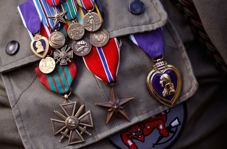 The medals of George Shenkle, a 93-year-old World War II veteran with the 82nd Airborn Division, are shown during a ceremony honoring those who fought in the Normandy campaign on the day before the 70th anniversary of D-Day June 5, 2014 in Picauville, France. (Win McNamee/Getty Images)