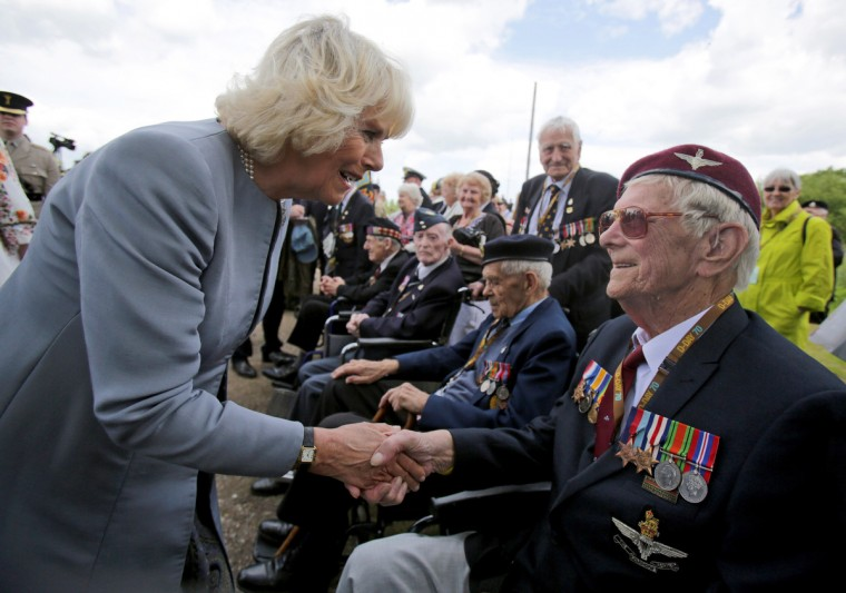 British Normandy Veteran Raymond Shuck, who was a paratrooper on D-Day shakes the hand of Camilla, Duchess of Cornwall as she meets veterans near Pegasus Bridge during D-Day Commemorations on June 5, 2014 in Ranville, near Caen in Normandy, France. (Matt Cardy/Getty Images)