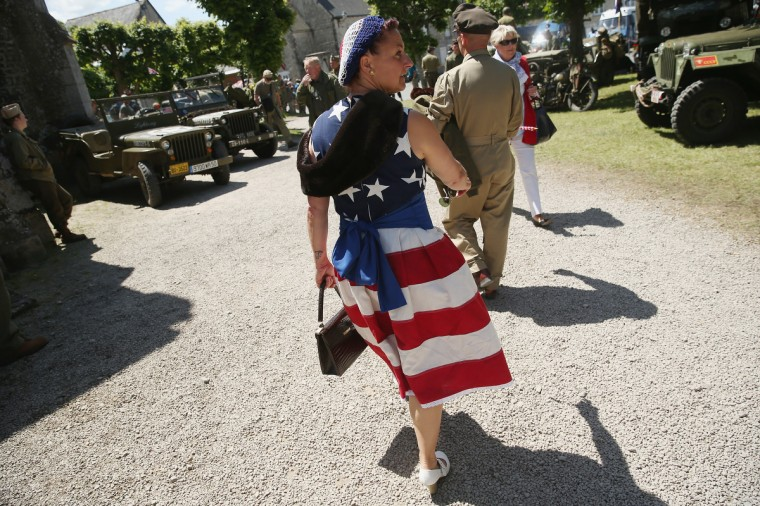 A D-Day re-enactment enthusiast wears the American flag at a re-enactment camp on June 5, 2014 near Utah Beach in Sainte Marie du Mont, France. (Sean Gallup/Getty Images)