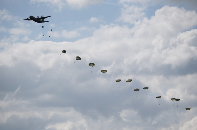 A parachute drop takes place on June 5, 2014 near Ranville, France. (Peter Macdiarmid/Getty Images)