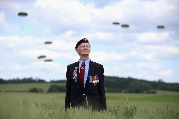 Fred Glover, aged 88, a veteran of the 9th Para Battalian watches a parachute jump just outside Rainville during D-Day 70 Commemorations on June 5, 2014 in Ranville, France. (Chris Jackson/Getty Images)