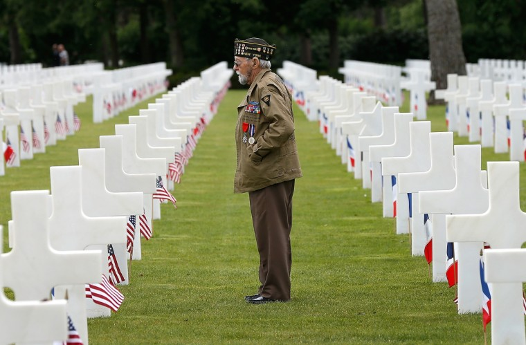 World War II veteran William Spriggs, 89, of the 83rd Infantry Division and who took part in the invasion of Normandy, searches for fallen comrades in the Normandy American Cemetery June 5, 2014 in Colleville-sur-Mer, France. (Win McNamee/Getty Images)