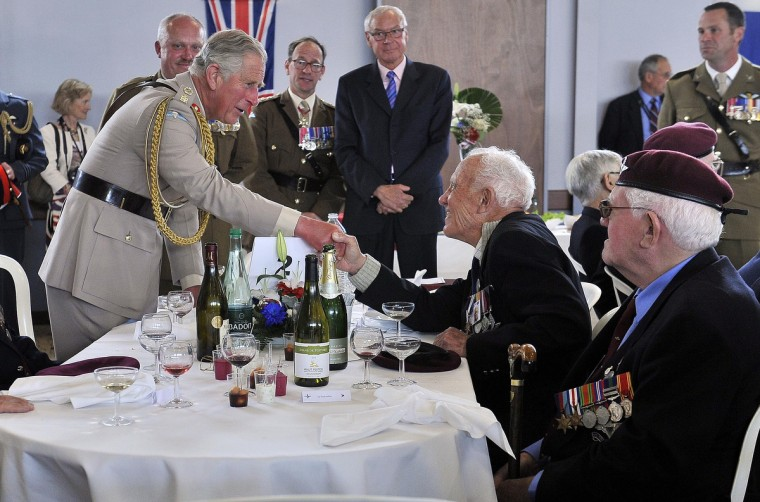 Prince Charles, Prince of Wales, Colonel-in-Chief, Army Air Corps, and Camilla, Duchess of Cornwall (not pictured) attend a lunch with D-day veterans at a community centre during the D Day 70 Commemoration on June 5, 2014 in Ranville, France. (Bruce Adams/Getty Images)