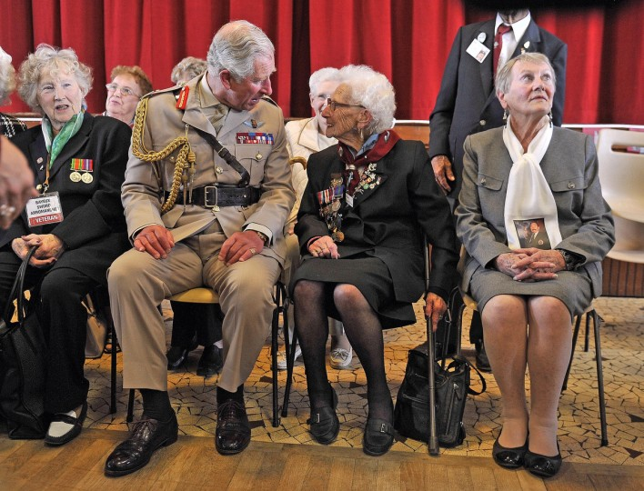 Prince Charles, Prince of Wales, Colonel-in-Chief, Army Air Corps, and Camilla, Duchess of Cornwall (not pictured) meet widows as they attend a lunch with D-day veterans at a community centre during the D Day 70 Commemoration on June 5, 2014 in Ranville, France. (Bruce Adams/Getty Images)