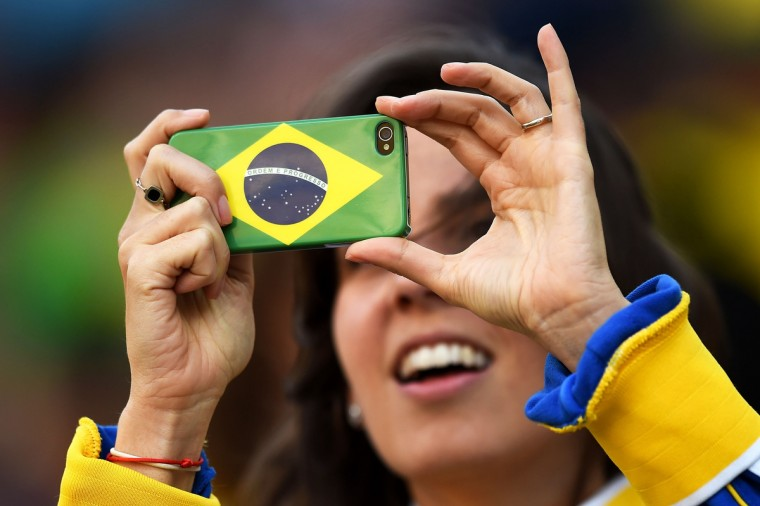 A Brazil fan takes a picture before the 2014 FIFA World Cup Brazil Group A match between Brazil and Croatia at Arena de Sao Paulo on June 12, 2014 in Sao Paulo, Brazil. (Christopher Lee/Getty Images)