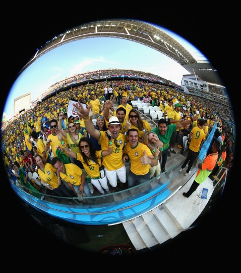 Fans celebrate prior to the 2014 FIFA World Cup Brazil Group A match between Brazil and Croatia at Arena de Sao Paulo on June 12, 2014 in Sao Paulo, Brazil. (Warren Little/Getty Images)