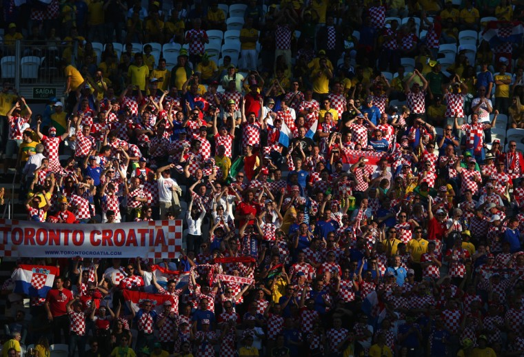 Fans celebrate prior to the 2014 FIFA World Cup Brazil Group A match between Brazil and Croatia at Arena de Sao Paulo on June 12, 2014 in Sao Paulo, Brazil. (Adam Pretty/Getty Images)