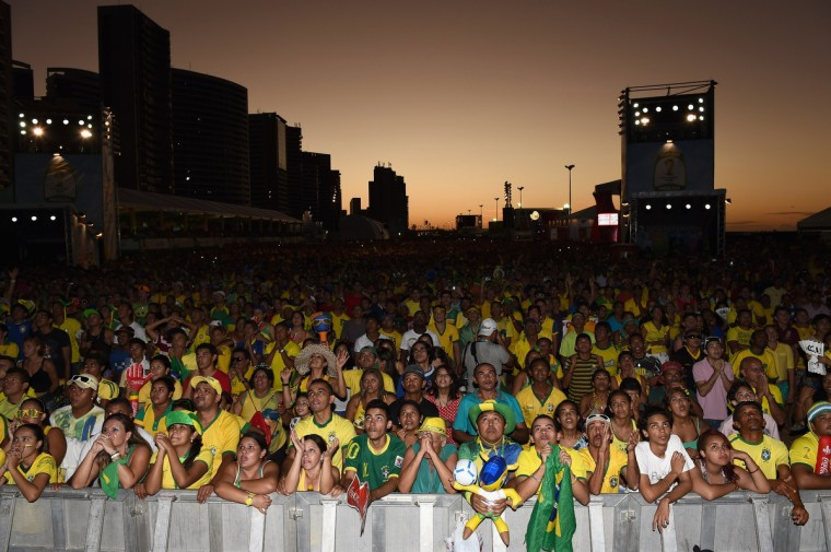 Brazil fans watch the opening match in the late evening sun at the FIFA Fan Fest on June 12, 2014 in Fortaleza, Brazil. (Laurence Griffiths/Getty Images)