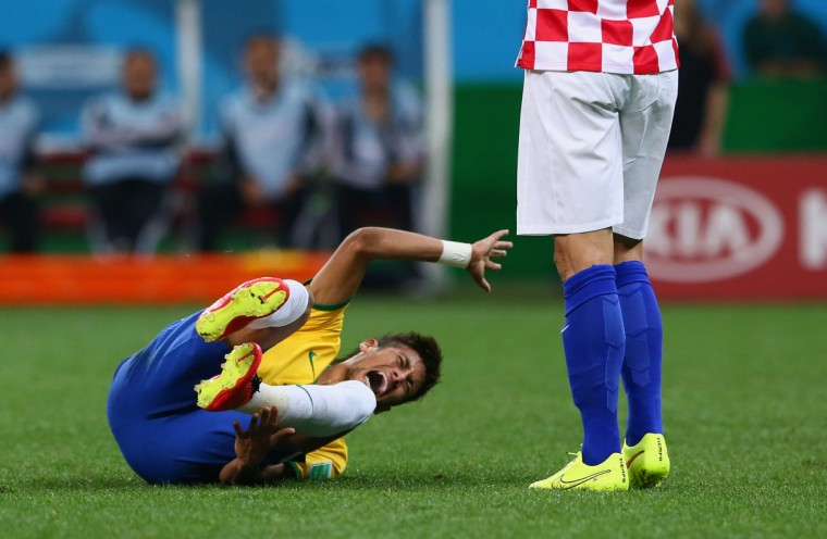 Neymar of Brazil lies on the field after a challenge in the second half during the 2014 FIFA World Cup Brazil Group A match between Brazil and Croatia at Arena de Sao Paulo on June 12, 2014 in Sao Paulo, Brazil. (Kevin Cox/Getty Images)