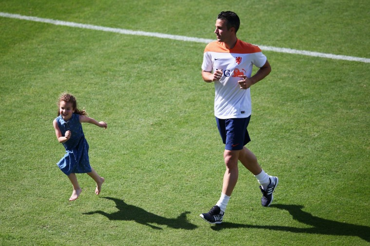Robin van Persie runs with his daughter, Dina Layla van Persie during the Netherlands training session at the 2014 FIFA World Cup Brazil held at the Estadio Jose Bastos Padilha Gavea on June 14, 2014 in Rio de Janeiro, Brazil. (Photo by Dean Mouhtaropoulos/Getty Images)