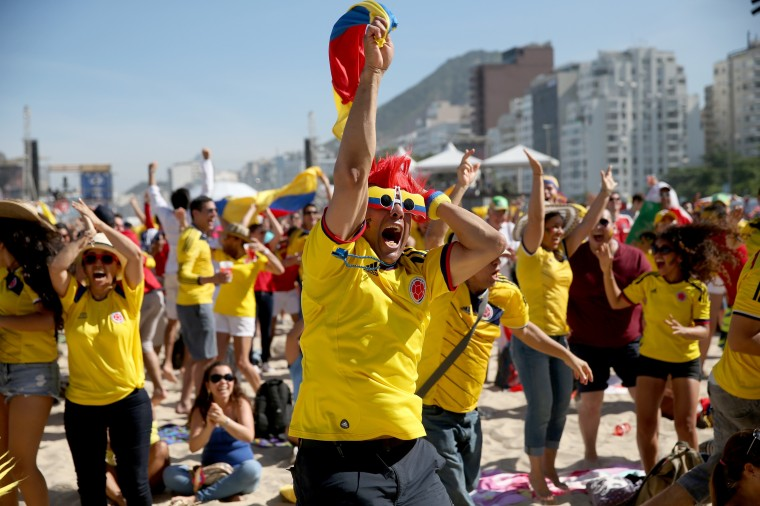 Colombian soccer team fans react as their team scores a goal against Greece as they watch the game on the giant screen showing the match at the FIFA World Cup Fan Fest on Copacabana beach on June 14, 2014 in Rio de Janeiro, Brazil. The match was played on the third day of the World Cup tournament. (Photo by Joe Raedle/Getty Images)