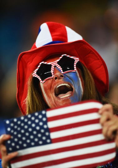 A United States fan holds an American flag prior to the 2014 FIFA World Cup Brazil Group G match between Ghana and the United States at Estadio das Dunas. (Jamie McDonald/Getty Images)
