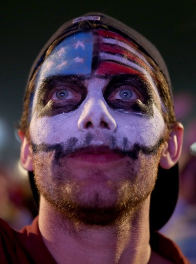 An American soccer fan waits for his team to play against Ghana at the FIFA World Cup Fan Fest on Copacabana beach in Rio de Janeiro, Brazil. (Joe Raedle/Getty Images)