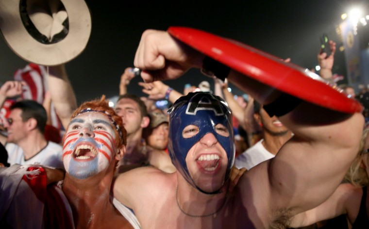 American soccer fans react to their team beating Ghana 2-1 as they watch on a large screen at the FIFA World Cup Fan Fest on Copacabana beach on June 16, 2014 in Rio de Janeiro, Brazil. (Joe Raedle/Getty Images)