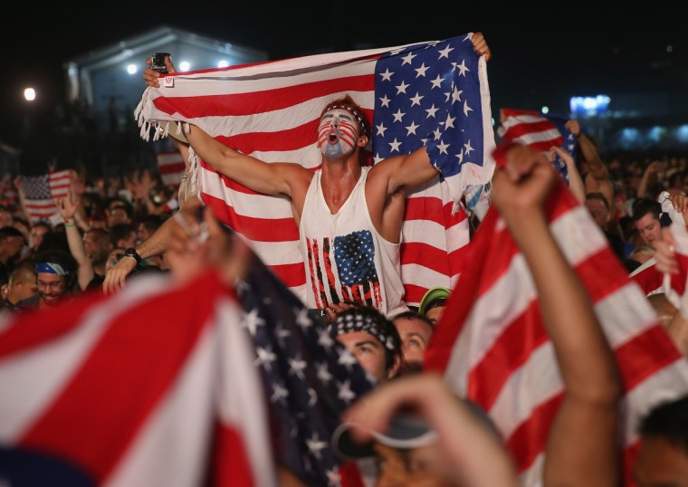 American soccer fans react to their team beating Ghana 2-1 as they watch on a large screen at the FIFA World Cup Fan Fest on Copacabana beach in Rio de Janeiro, Brazil. (Joe Raedle/Getty Images)