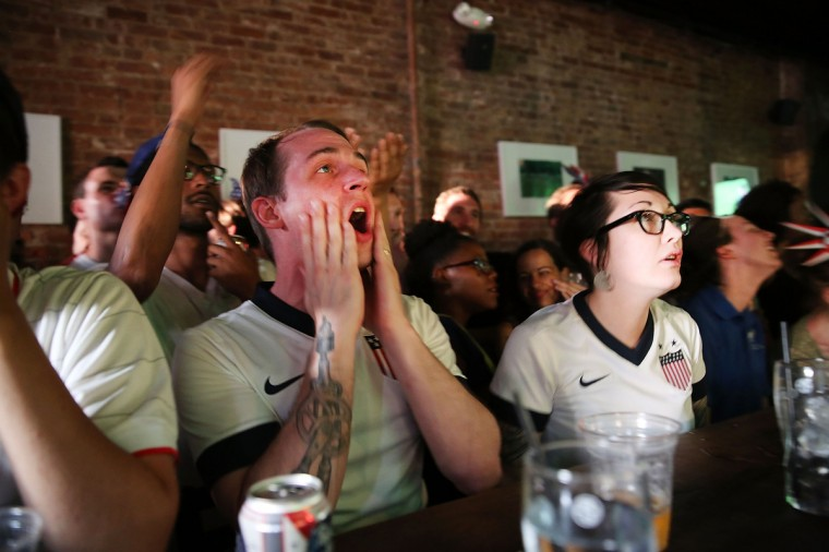United States soccer fans react during the match between Ghana and USA at the WoodWork bar in the Brooklyn borough of New York City. (Spencer Platt/Getty Images)