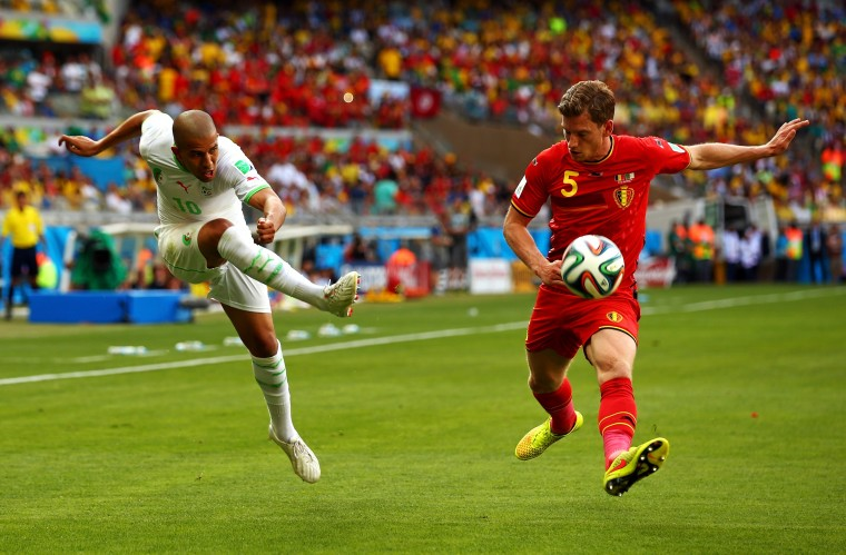 Sofiane Feghouli of Algeria shoots against Jan Vertonghen of Belgium during the 2014 FIFA World Cup Brazil Group H match between Belgium and Algeria at Estadio Mineirao on June 17, 2014 in Belo Horizonte, Brazil. (Photo by Ian Walton/Getty Images)