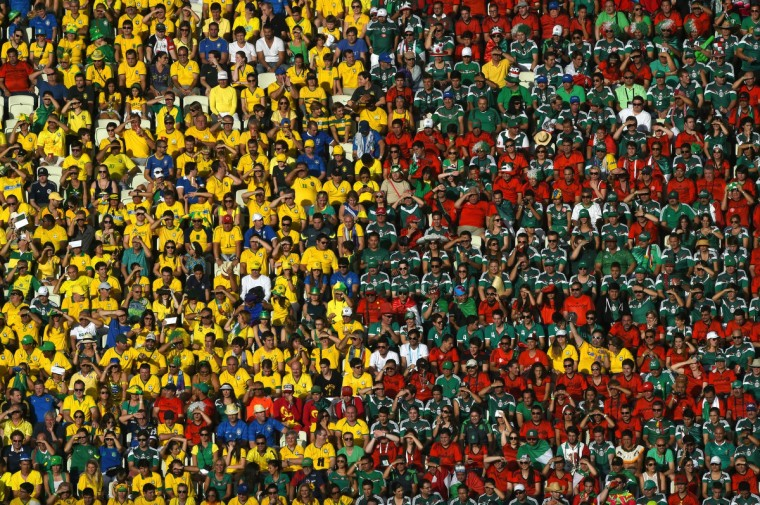 Brazil and Mexico fans look on during the 2014 FIFA World Cup Brazil Group A match between Brazil and Mexico at Castelao on June 17, 2014 in Fortaleza, Brazil. (Jamie McDonald/Getty Images)