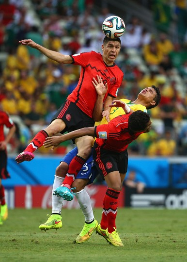 Oribe Peralta of Mexico goes up for a header against Thiago Silva of Brazil during the 2014 FIFA World Cup Brazil Group A match between Brazil and Mexico at Castelao on June 17, 2014 in Fortaleza, Brazil. (Robert Cianflone/Getty Images)