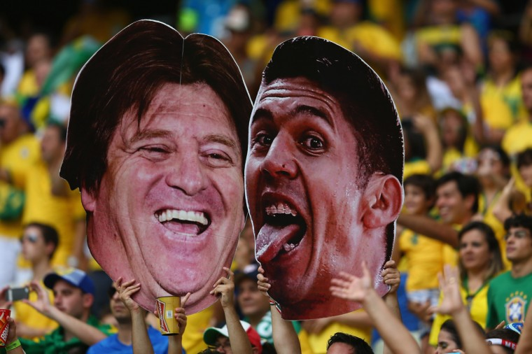 Fans hold up cutouts during the 2014 FIFA World Cup Brazil Group A match between Brazil and Mexico at Castelao on June 17, 2014 in Fortaleza, Brazil. (Michael Steele/Getty Images)
