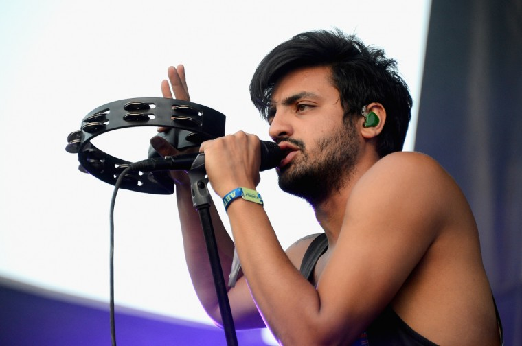 Sameer Gadhia of Young The Giant performs onstage during day 2 of the Firefly Music Festival on June 20, 2014 in Dover, Delaware. (Theo Wargo/Getty Images)