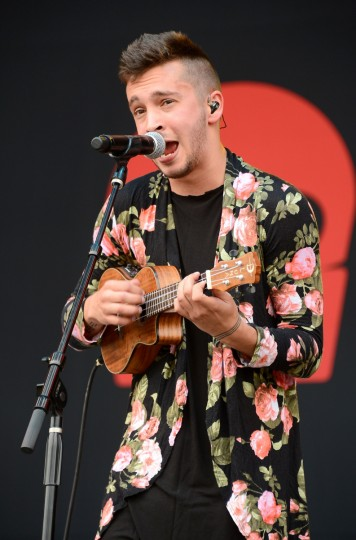 Tyler Joseph of Twenty One Pilots performs onstage during day 3 of the Firefly Music Festival on June 21, 2014 in Dover, Delaware. (Theo Wargo/Getty Images)