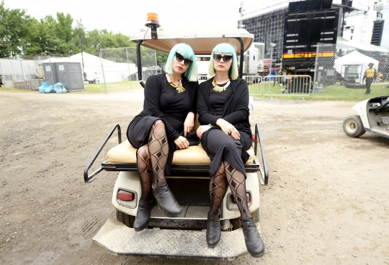Jess Wolfe (L) and Holly Laessig of Lucius pose backstage during day 3 of the Firefly Music Festival on June 21, 2014 in Dover, Delaware. (Michael Loccisano/Getty Images)